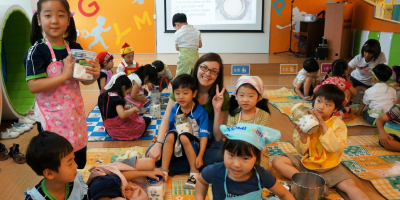 Teacher surrounded by children